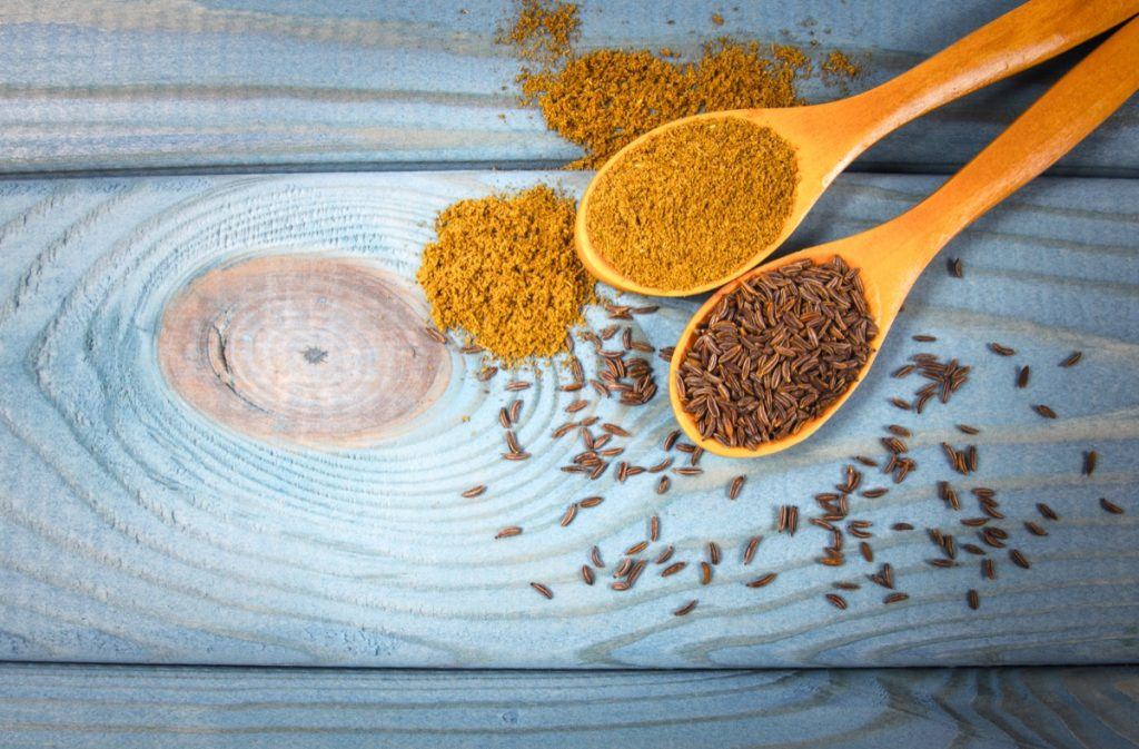 Close up on ground cumin in a spoon