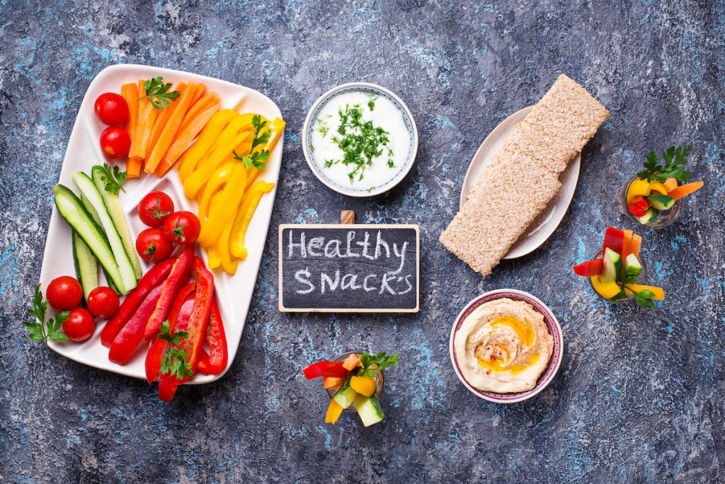 Healthy snacks. Fresh vegetables with sauces and hummus